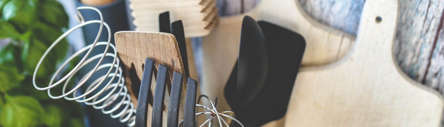 Kitchen tools with rustic background