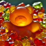 small multi-colored gummy bears and a large gummy bear